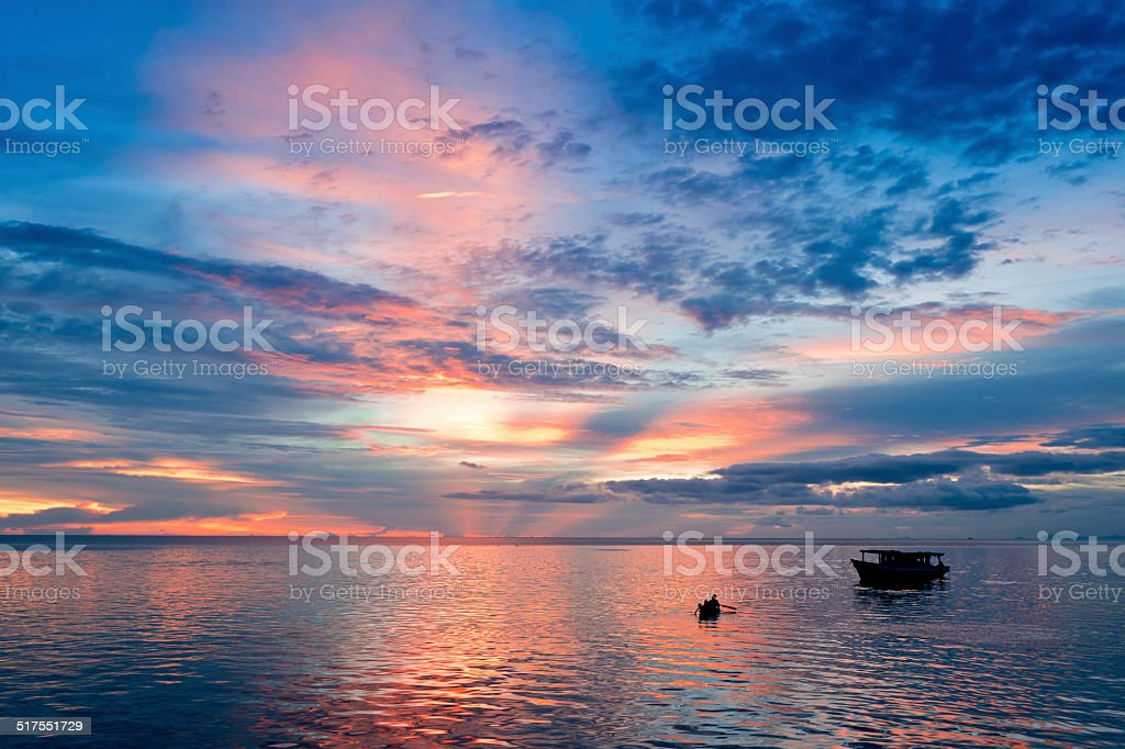 Sunset Boat Rowing stock photo
