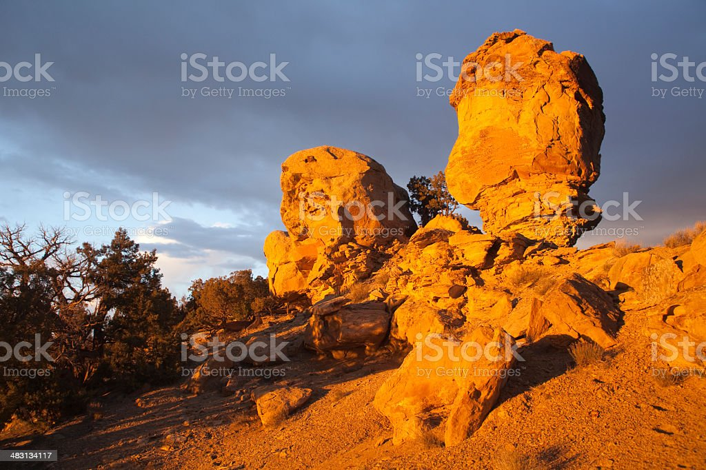 Sunset branches and storm over Colorado's Cathedral Bluffs stock photo