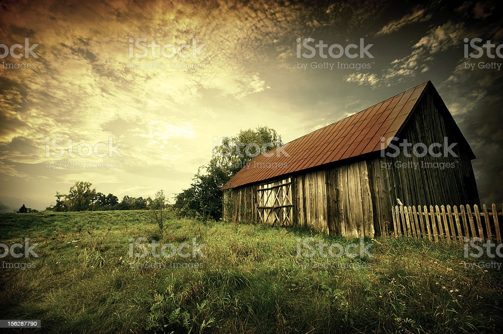 sunset by an old barn stock photo