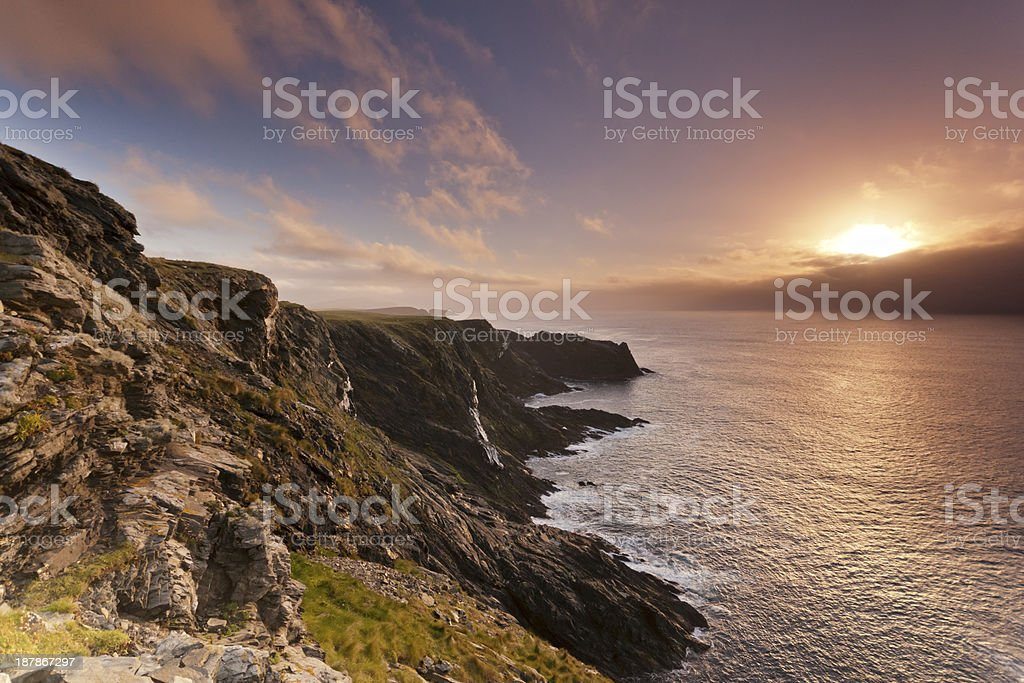 Sunset by cliffs and sea on Shetland's west coast stock photo