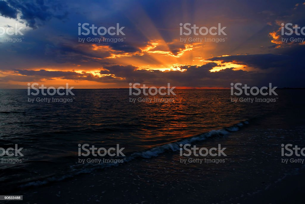sunset by the sea stock photo