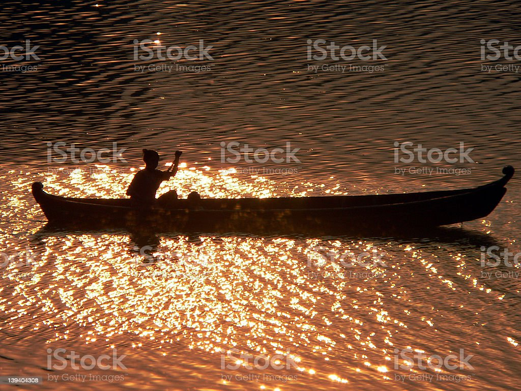 Sunset Canoeist Irrawaddy River royalty-free stock photo
