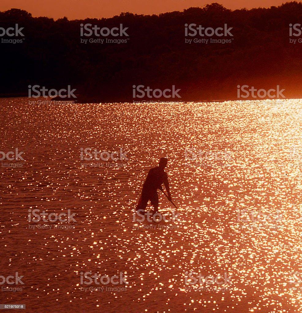 sunset clamming stock photo