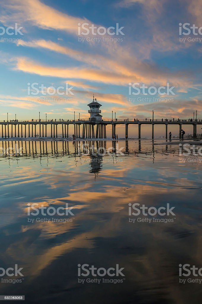 Sunset cloud reflection at pier stock photo