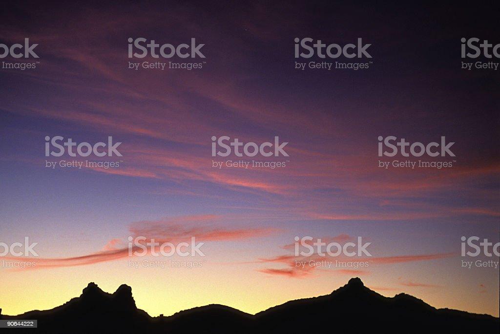 sunset cloud sky and mountain ridge silhouette landscape stock photo