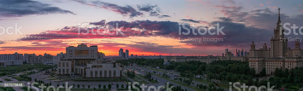 Sunset clouds above Moscow university campus stock photo