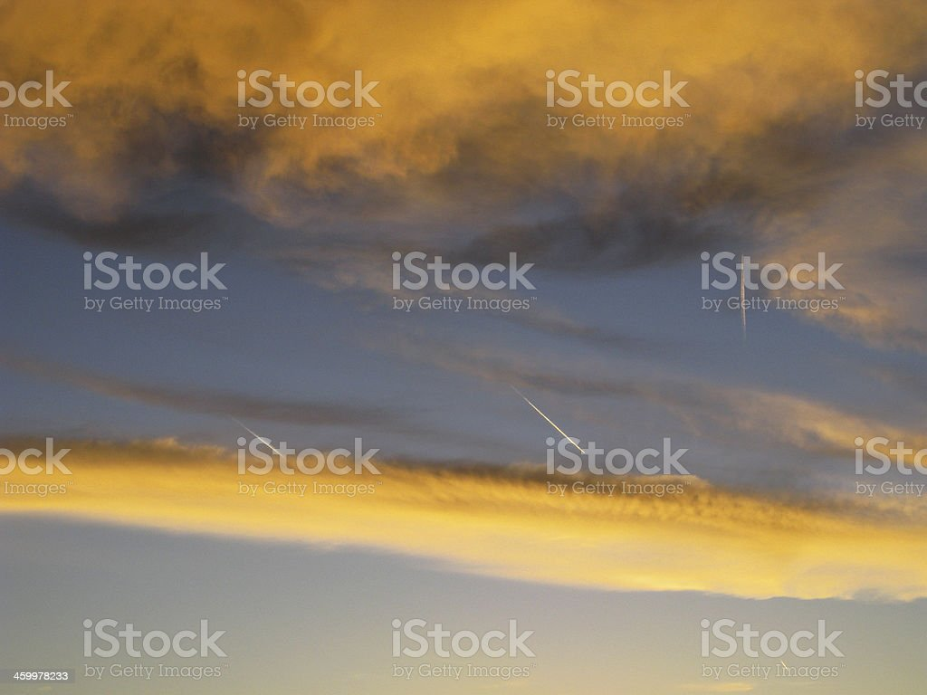 Sunset Clouds Jet Trails royalty-free stock photo