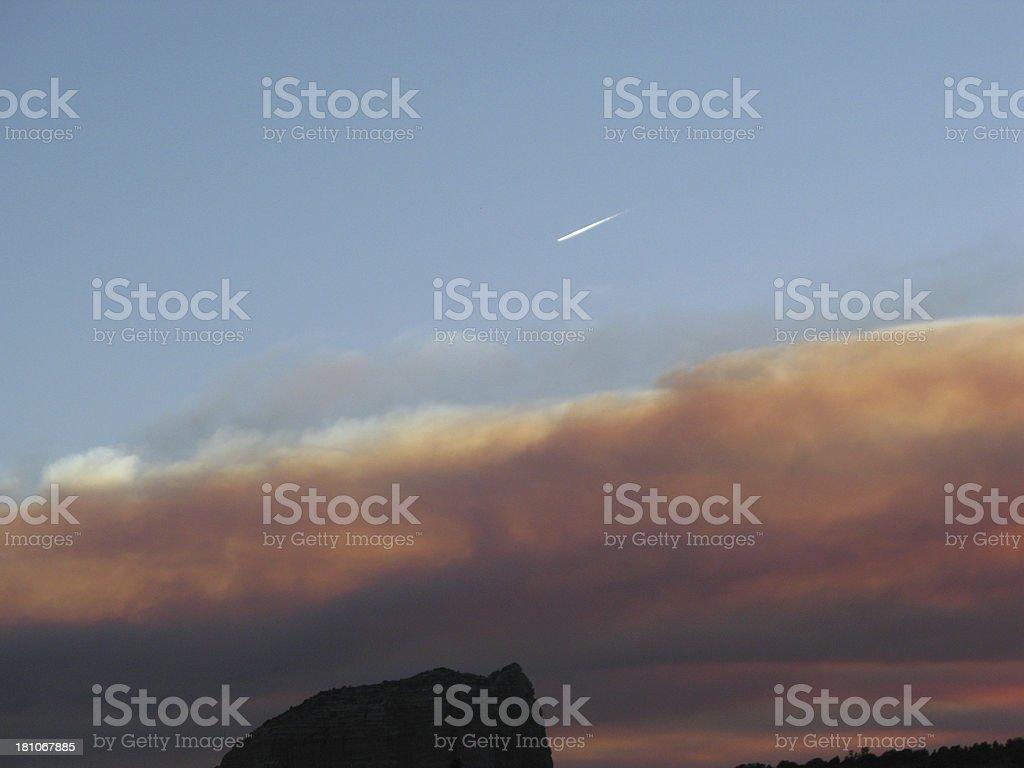Sunset Clouds Smoke Plane royalty-free stock photo