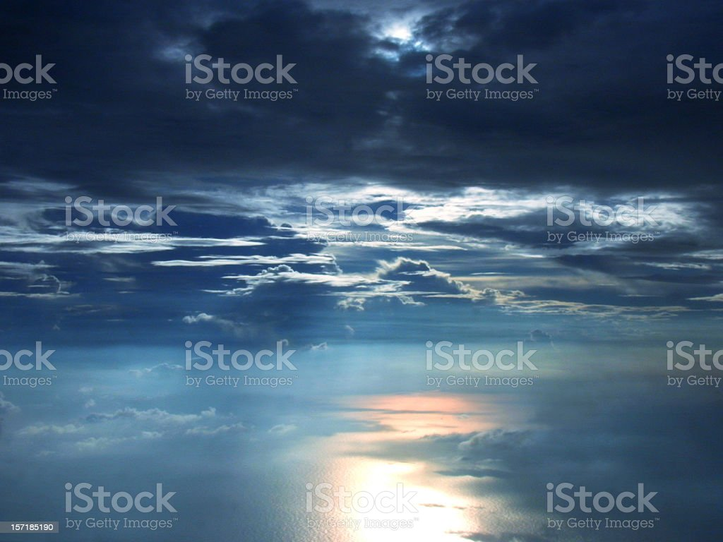 Sunset Cloudscape with Sunlight Reflection from the Ocean royalty-free stock photo