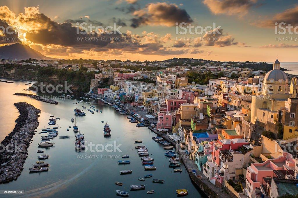 Sunset cloudy at harbor Corricella stock photo