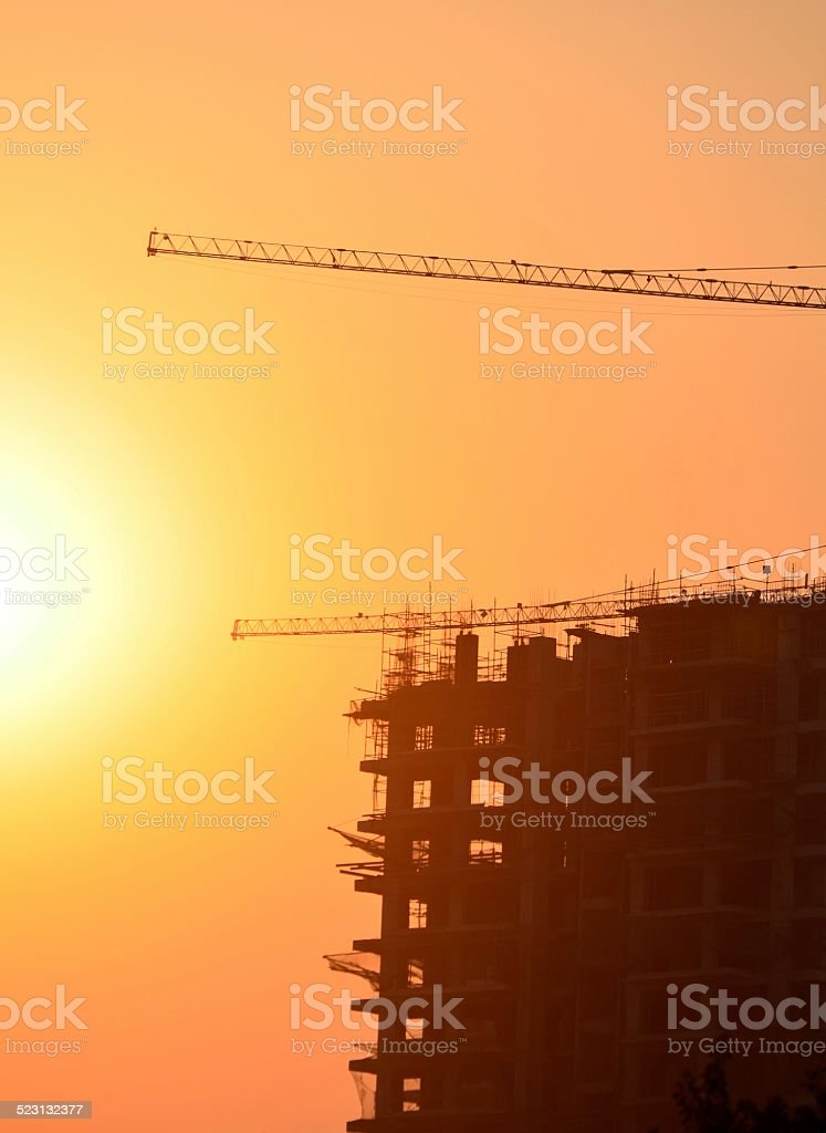 sunset, construction site and colorful sky, end of day stock photo
