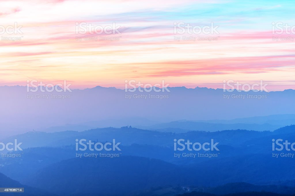 Sunset, contrails and cloudy sky,evening,Sabotin,Primorska,Slovenia stock photo