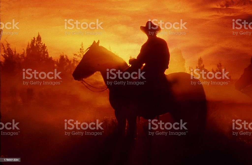 sunset cowboy stock photo