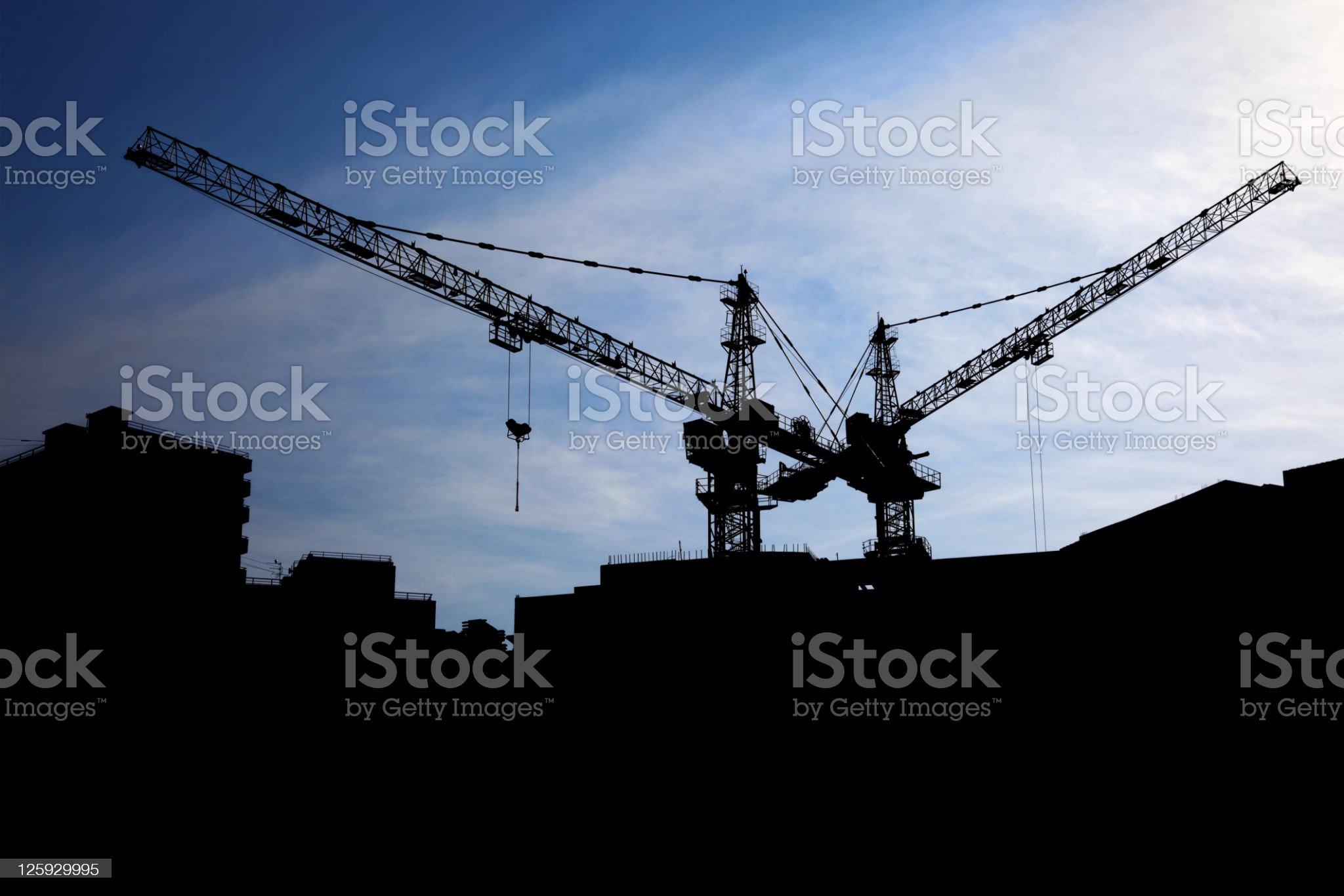 Sunset cranes royalty-free stock photo