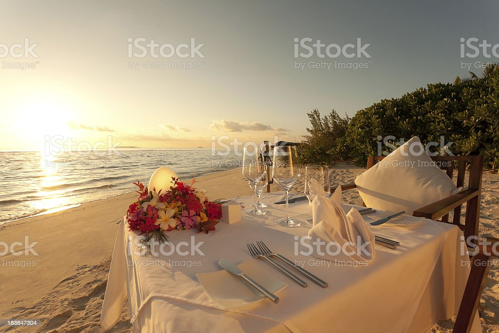 sunset dinner table stock photo