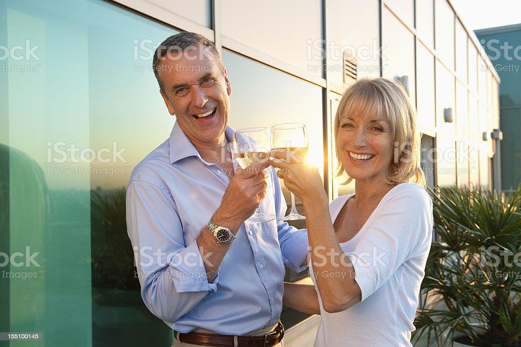 Sunset Drinks - Senior Couple royalty-free stock photo