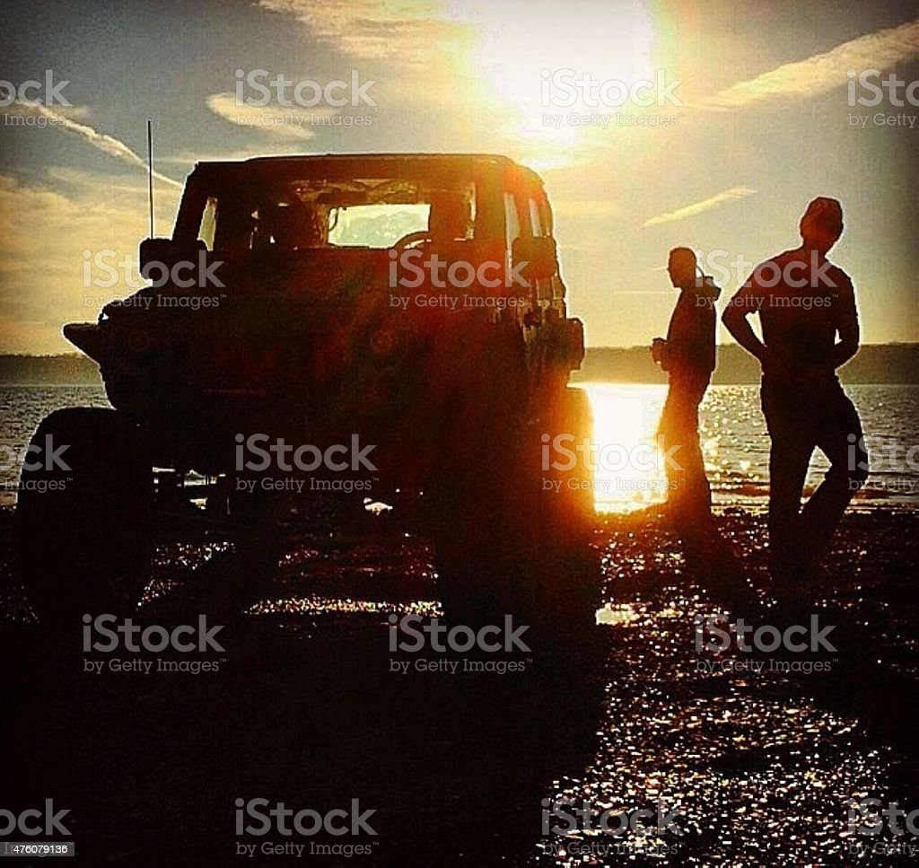 Sunset during the cleaning of jeeps after off-roading stock photo