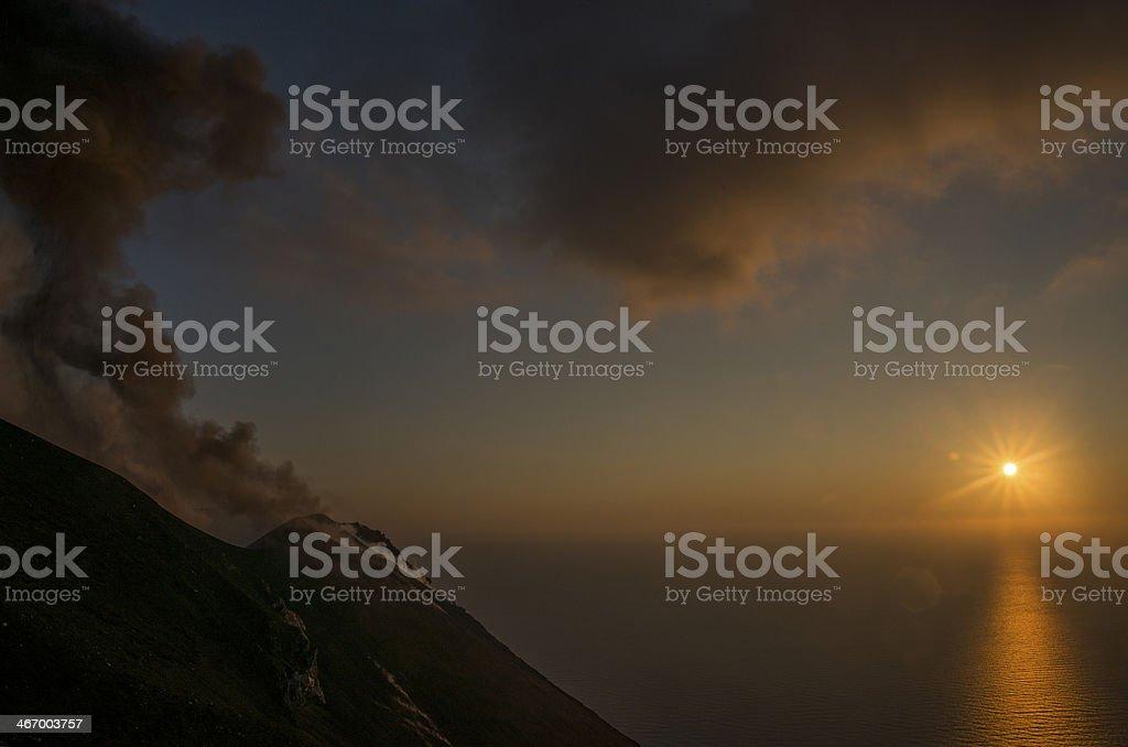 Sunset during Volcano eruption stock photo