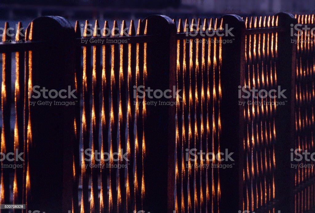 sunset fence stock photo