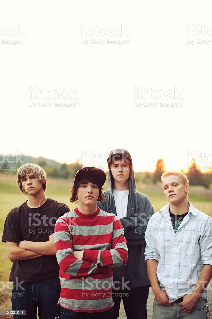 Sunset Field Group Young Men royalty-free stock photo