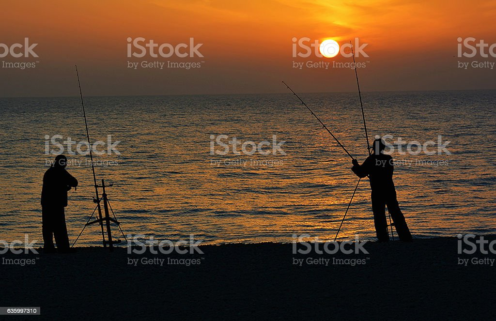 Sunset fishing stock photo