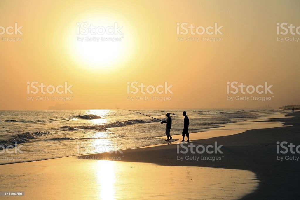 Sunset fishing, Salalah, Oman royalty-free stock photo