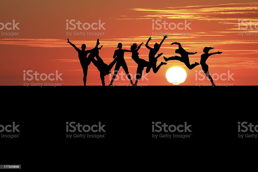 sunset friends royalty-free stock photo