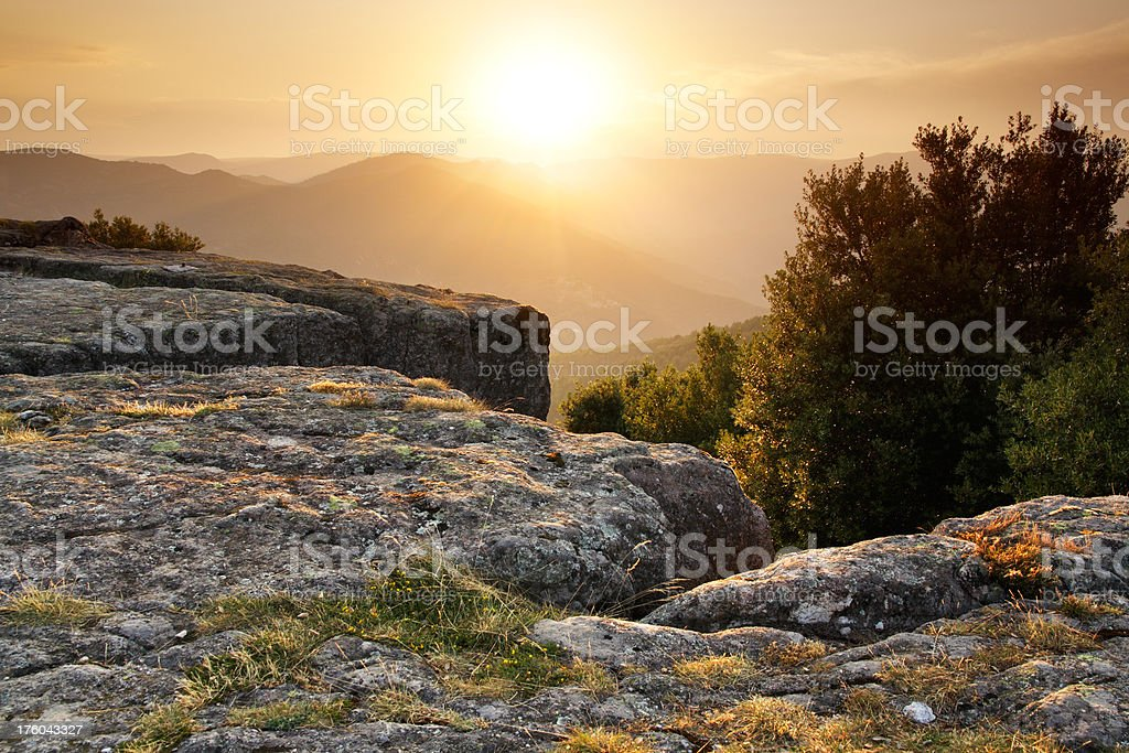 Sunset from a rock stock photo