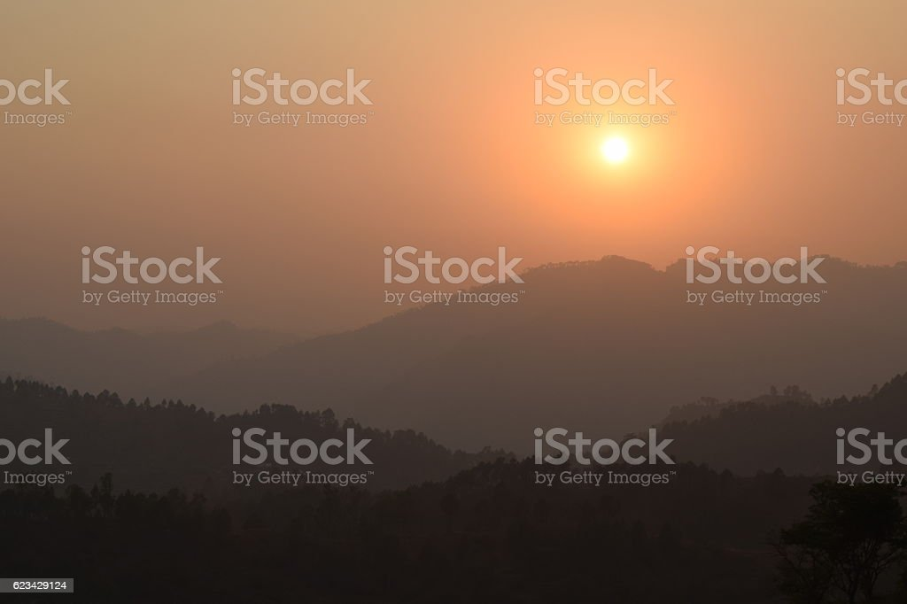 Sunset from top of the hill stock photo