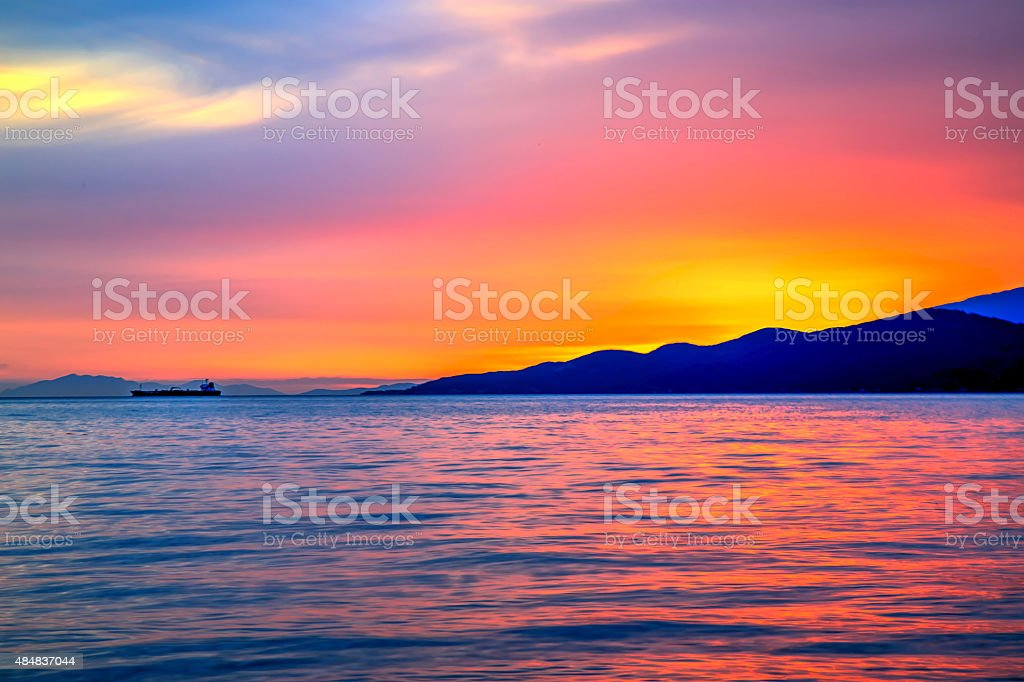 sunset glow in a cloudy evening stock photo