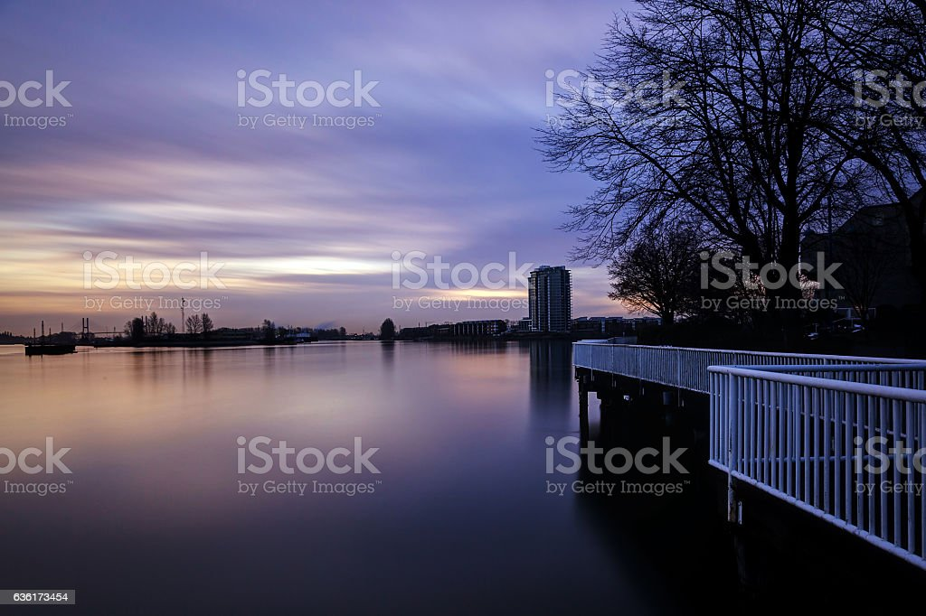 Sunset glow over river stock photo