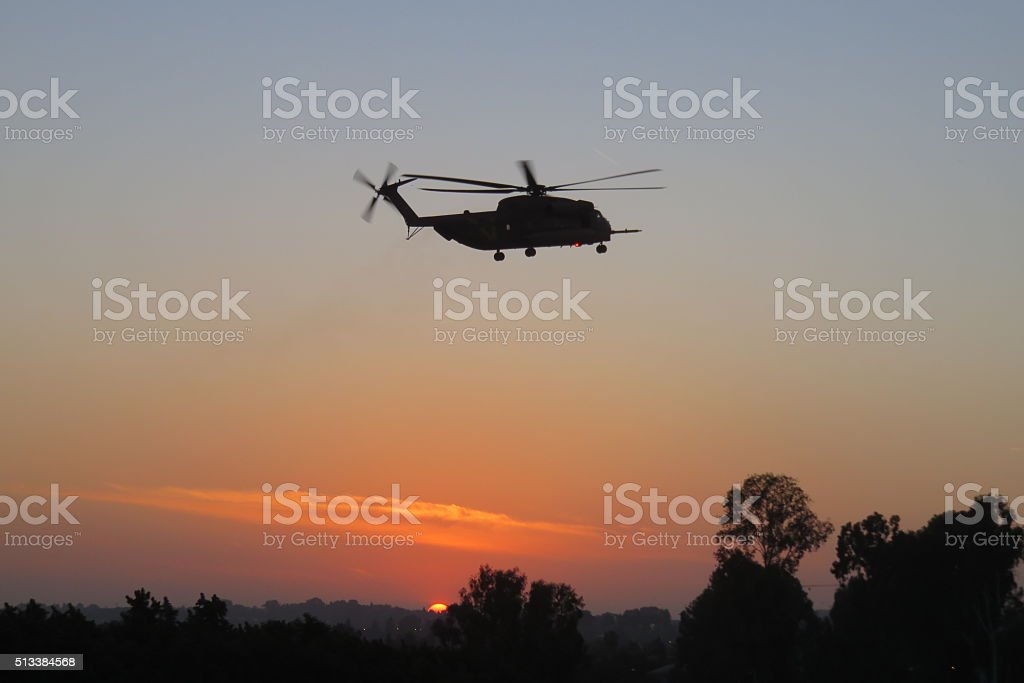 Sunset helicopter stock photo