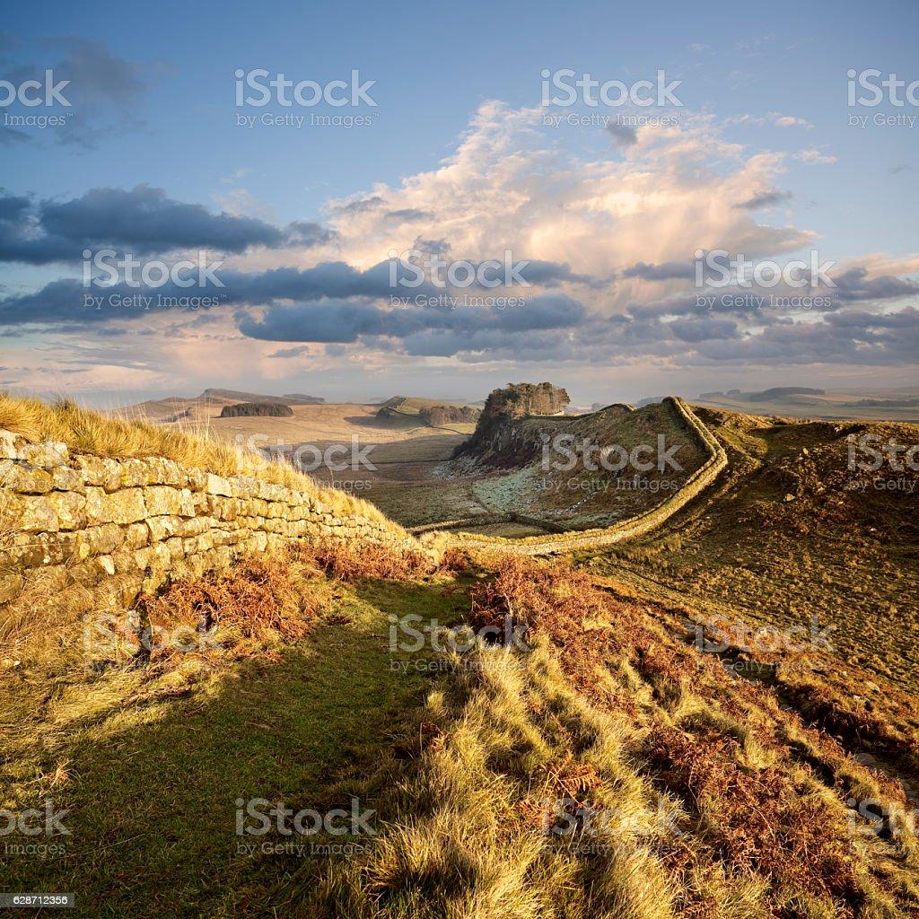 Sunset illuminates Hadrian's Wall in Northumberland, England stock photo