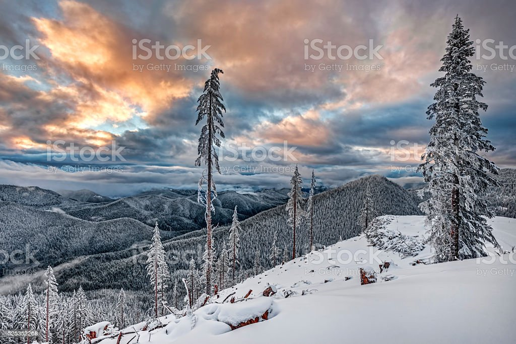 Sunset Illuminates Snowy Cascade Mountain Valley stock photo