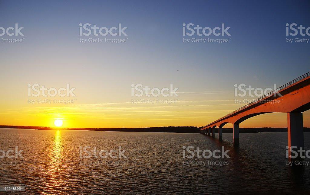 sunset in alqueva lake and bridge stock photo