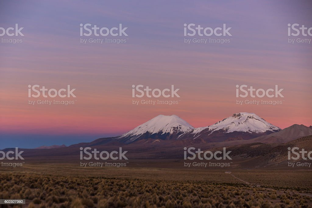 Sunset in Andes. Parinacota and Pomerade volcanos. stock photo