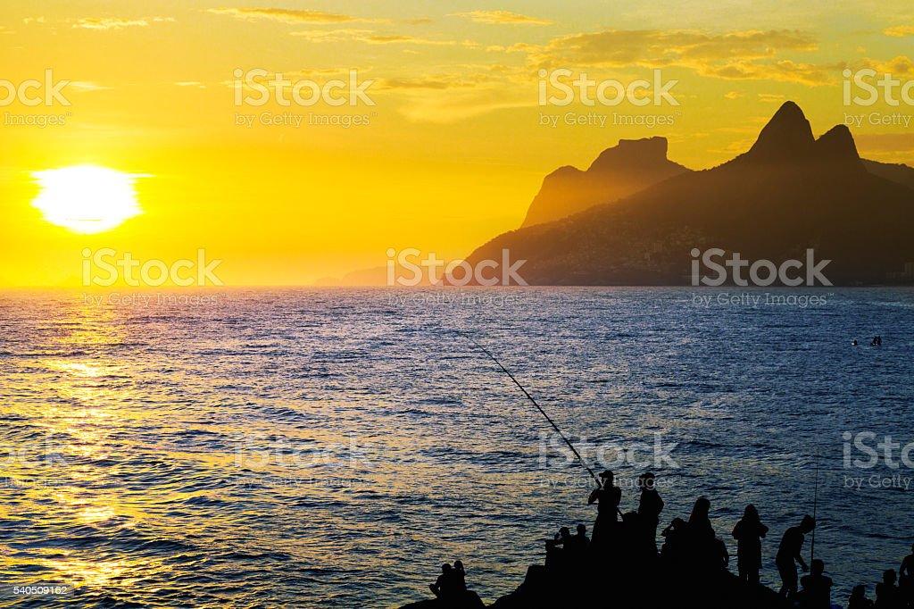 Sunset in Arpoador Beach - Rio de Janeiro stock photo