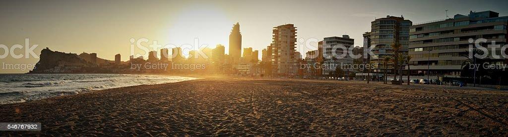 Sunset in Benidorm beach stock photo