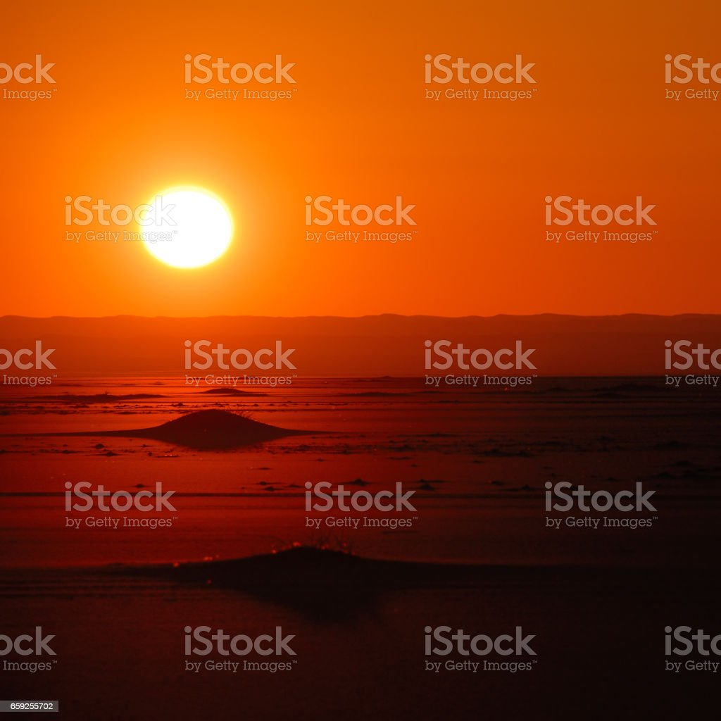 Sunset in desert stock photo
