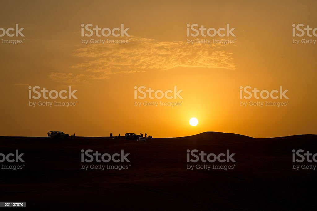 Sunset in dessert of Dubai stock photo