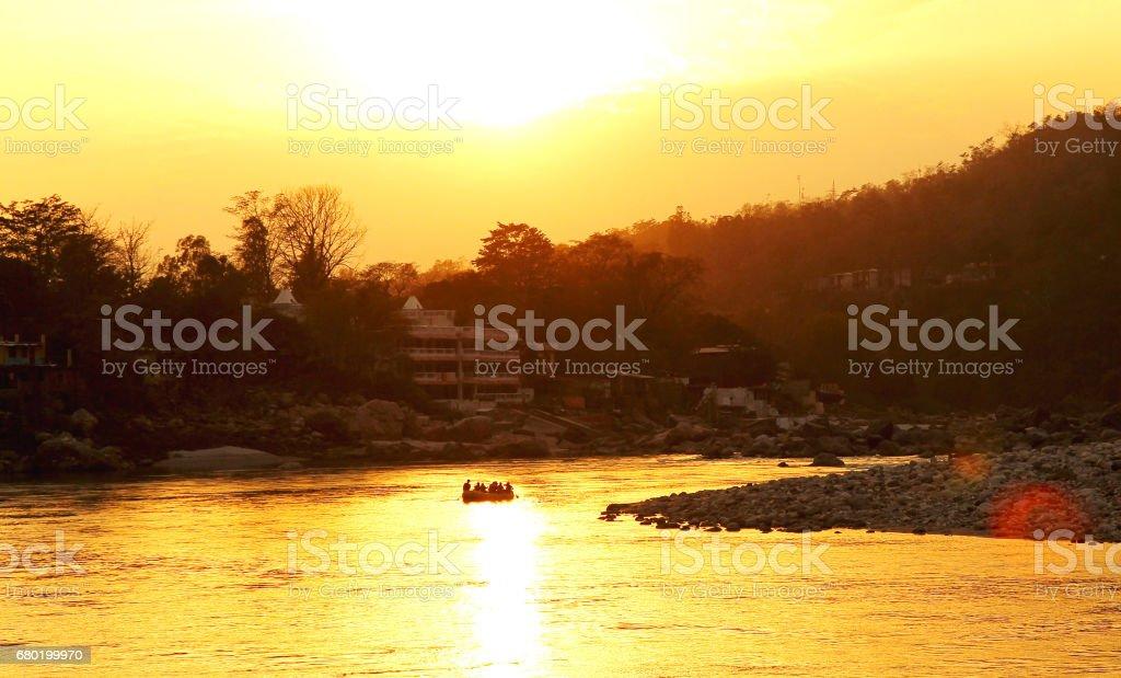 RISHIKESH, INDIA - sunset in Ganga river, boat rafting stock photo