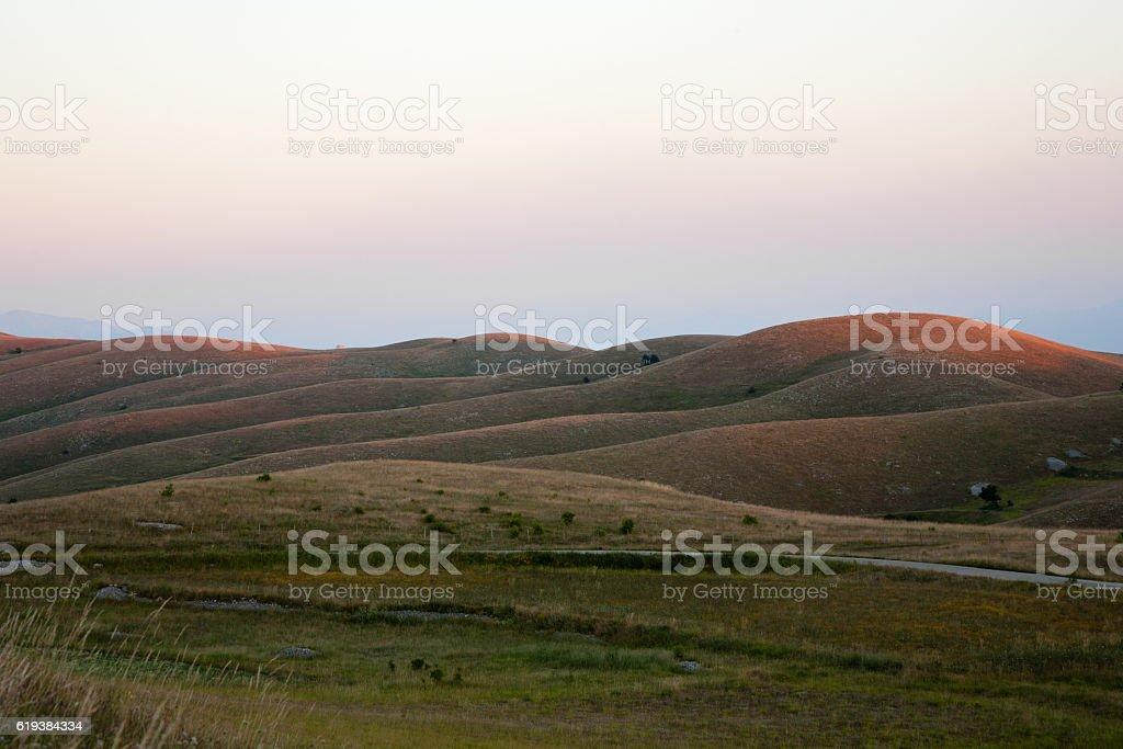 Sunset in Gran Sasso' hills (Abruzzo - Italy) stock photo