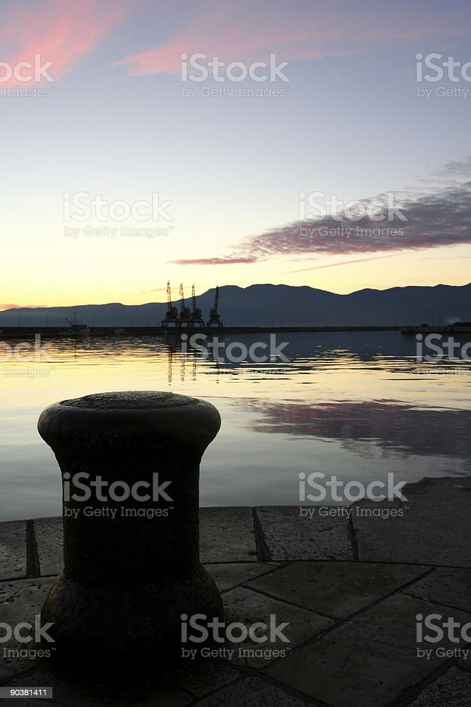 sunset in harbor royalty-free stock photo