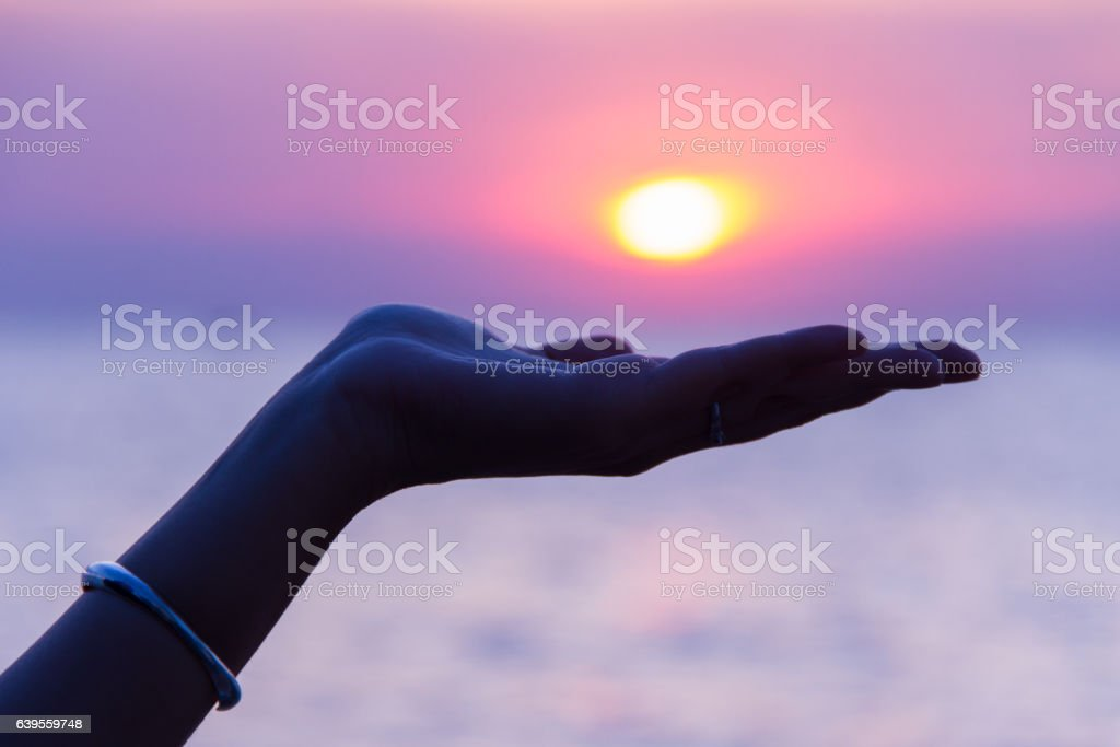 sunset in her hand stock photo