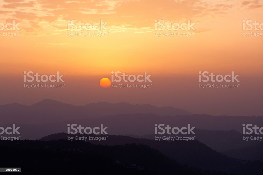 Sunset in hills royalty-free stock photo