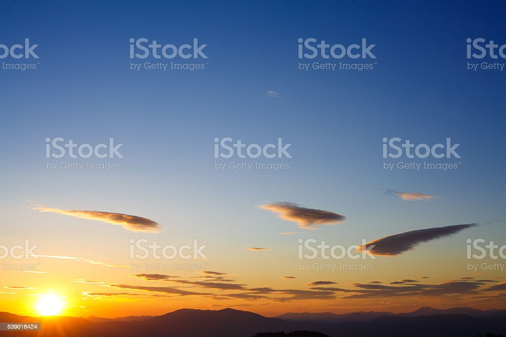 Sunset in mountains stock photo