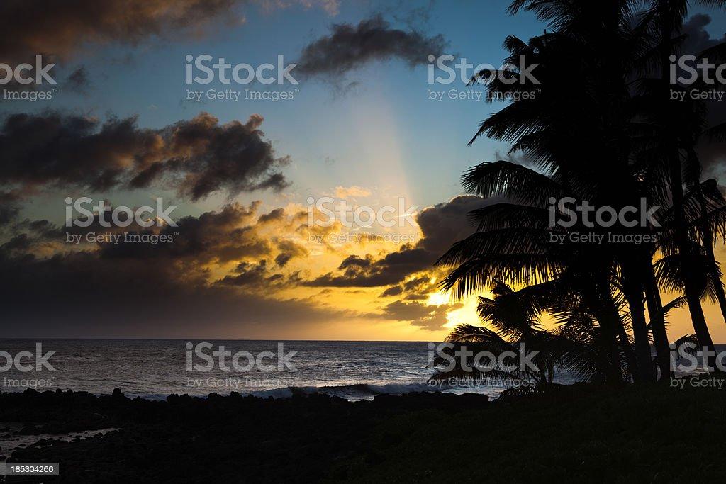 Sunset in Poipu Beach of Kauai Hawaii stock photo