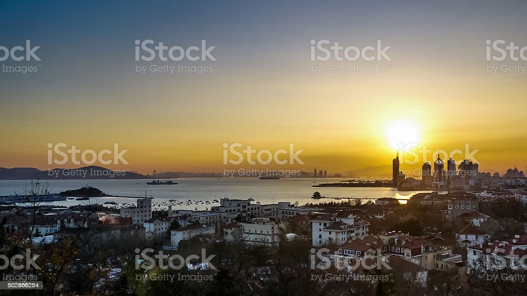 Sunset in Qingdao bay stock photo