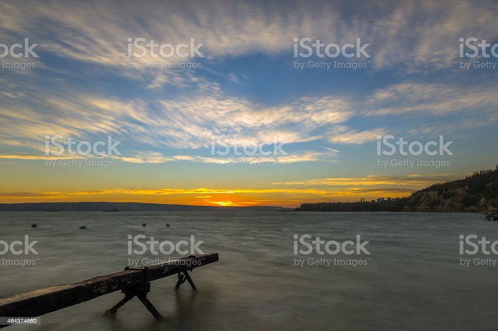 Sunset in the bay of fishermen stock photo