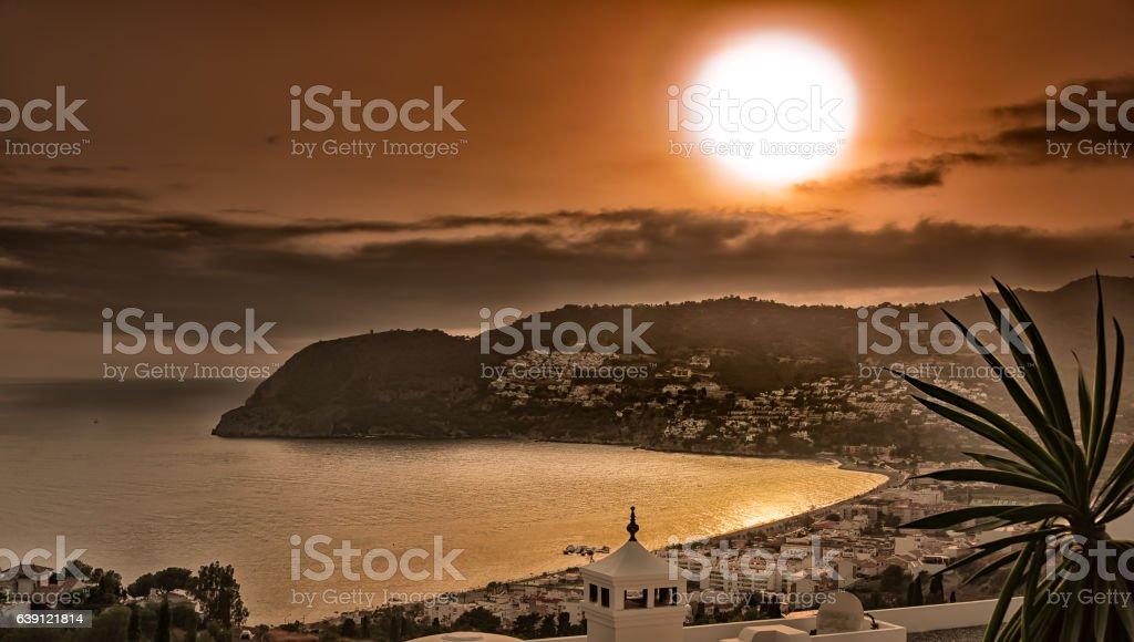Sunset in the Bay of La Herradura, Granada. stock photo